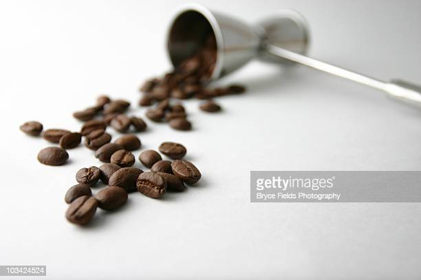 A Jigger with coffee beans