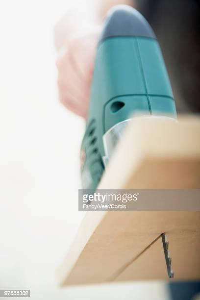 jigsaw cutter - stichsäge stock-fotos und bilder
