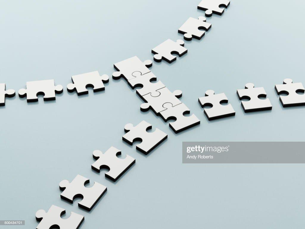 Jigsaw pieces bridging the gap : Stock Photo