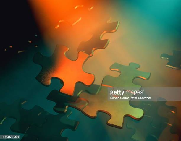 Jigsaw pieces floating.