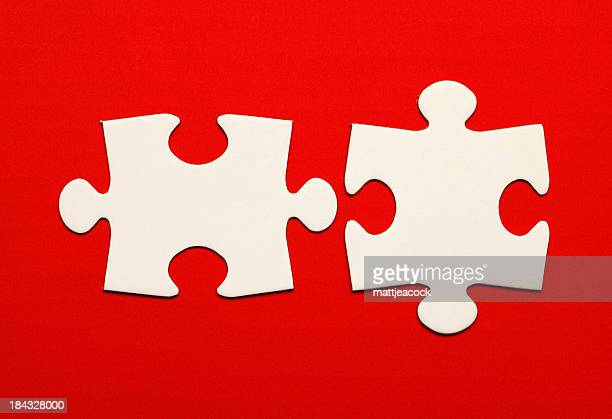 Jigsaw pieces on red background