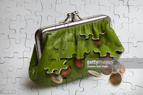 Jigsaw purse falling apart spilling money
