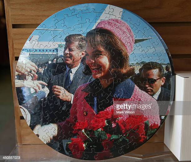 A jigsaw puzzle featuring President John F Kennedy and his wife Jacqueline Kennedy are for sale at the gift shop at Arlington Cemetery on November 19...
