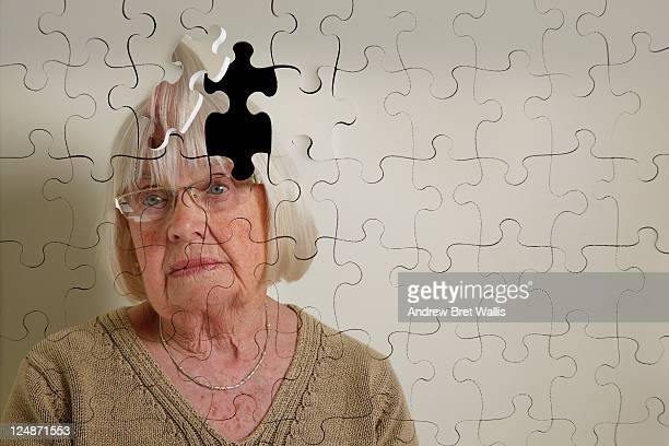 Jigsaw puzzle, of a senior woman, falling apart