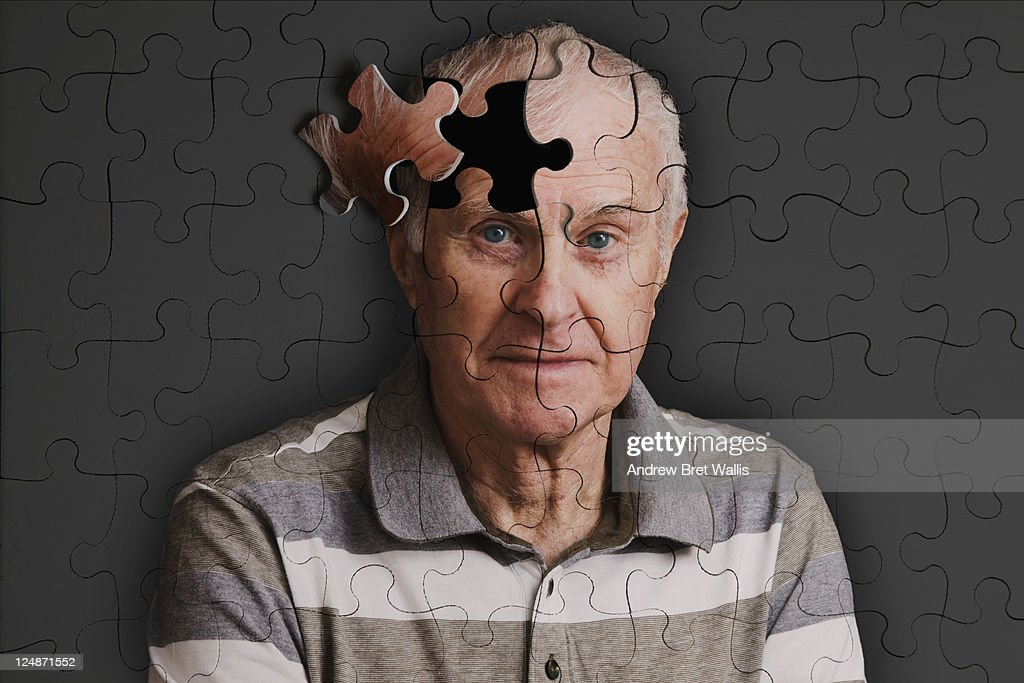 Jigsaw puzzle, of senior man, falling apart : Stock Photo