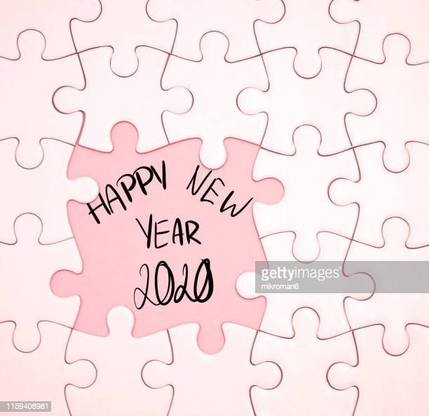 jigsaw puzzle on blue background - 新年レセプション ストックフォトと画像