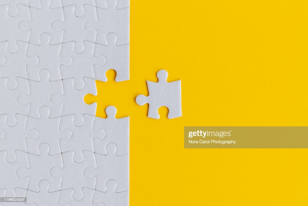 Jigsaw Puzzle on Yellow Background : Photo