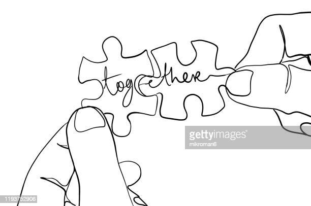 jigsaw puzzle one line drawing with togetherness - lineart stock-fotos und bilder