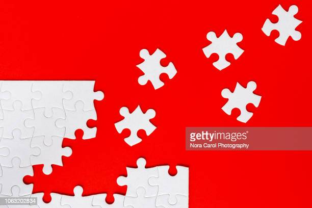 jigsaw puzzle - business strategy stock photos and pictures