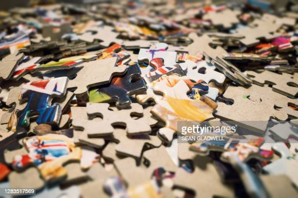 jigsaw puzzle pile - part of stock pictures, royalty-free photos & images