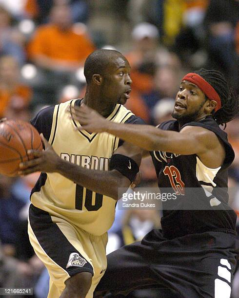 Jihad Muhammad guards Brandon McKnight in the first half of Cincinnati's 7959 win over Purdue in the John Wooden Tradition in Conseco Fieldhouse...