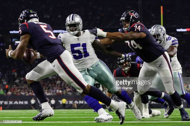 Jihad Ward of the Dallas Cowboys pressures Joe Webb of the Houston Texans in the first half of the preseason game at NRG Stadium on August 30, 2018...