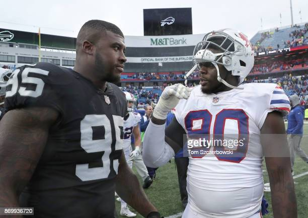 Jihad Ward of the Oakland Raiders meets with Shaq Lawson of the Buffalo Bills after their NFL game at New Era Field on October 29 2017 in Buffalo New...