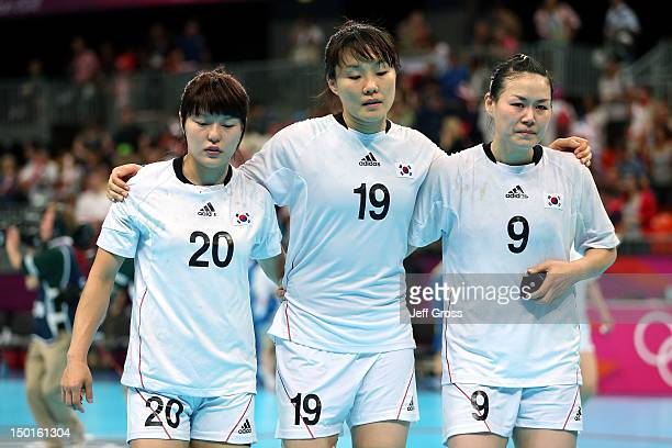 Jihae Jung Im Jeong Choi and Cha Youn Kim of South Korea react after losing to Spain in the Women's Handball Bronze Medal Match on Day 15 of the...