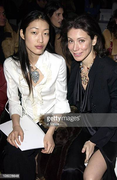 Jihae Kim and Angela Tassoni Newley during MercedesBenz Fashion Week Fall 2003 Collections Lloyd Klein Front Row at Bryant Park in New York City New...