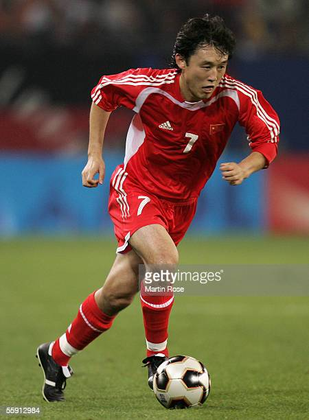 Jihai Sun of China runs with the ball during the friendly game between Germany and China at the AOL Arena on October 12, 2005 in Hamburg, Germany.