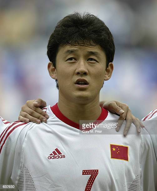 Jihai Sun of China sings the Chinese national anthem before the first half during the China v Costa Rica, Group C, World Cup Group Stage match played...