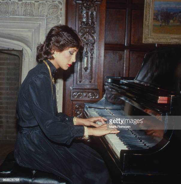 Jihan Sadat daughter of Anwr Sadat plays the piano at the National Press Club in Washington DC October 13 1982
