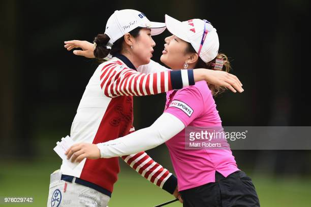 JiHee Lee and AhReum Hwang of South Korea hug on the 18th green during the second round of the Nichirei Ladies at the Sodegaura Country Club Shinsode...