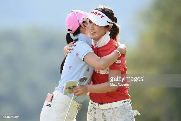 JiHee Lee of South Korea and ChaeYoung Yoon of South Korea hug on the 18th green during the third round of the 50th LPGA Championship Konica Minolta...