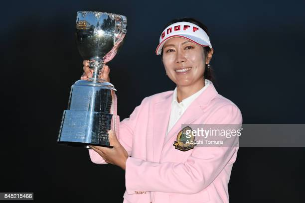 JiHee Lee of South Korea poses with the trophy after winning the 50th LPGA Championship Konica Minolta Cup 2017 at the Appi Kogen Golf Club on...
