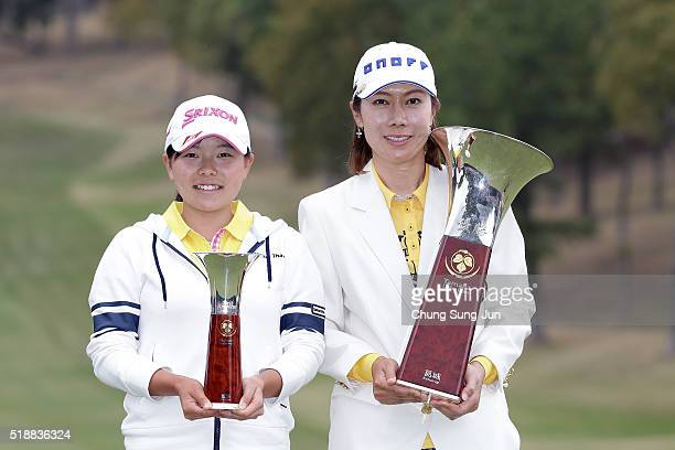 JiHee Lee South Korea and Minami Katsu of Japan pose with the trophy during a ceremony following the YAMAHA Ladies Open Katsuragi at the Katsuragi...