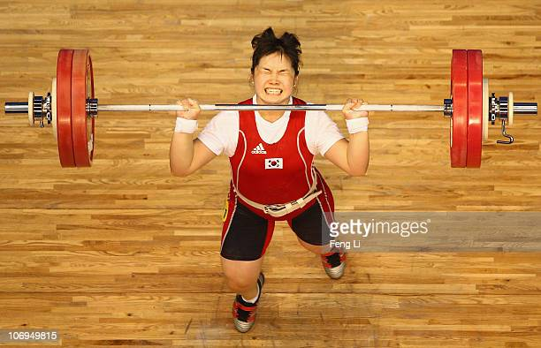 Jihye Lim of South Korea competes in the weightlifting Women's 75 kg Group A during day six of the 16th Asian Games Guangzhou 2010 at Dongguan...