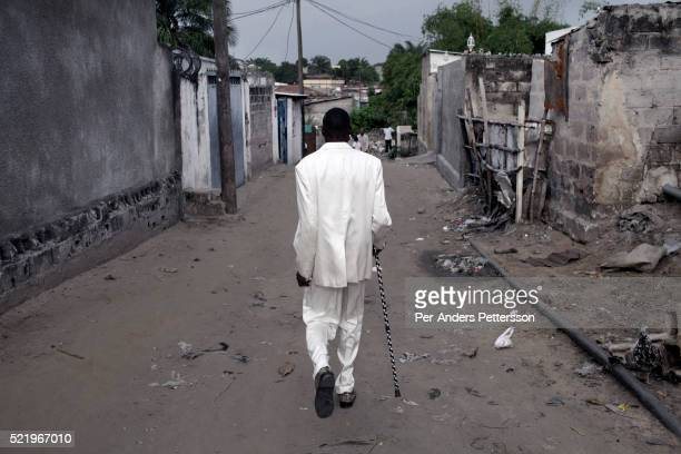 Jika a senior Sapeur takes a walk in his white diamond suit close to his home in the Mombele area on February 12 2012 in Kinshasa DRC Jika loves...