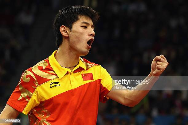 Jike Zhang of China celebrates a point in the Men's Doubles Final with Hao Wang of China against Lin Ma and Xin Xu of China at Guangzhou Gymnasium...