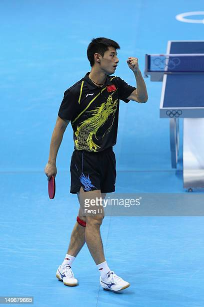Jike Zhang of China celebrates after his Men's Singles Table Tennis semifinal match against Dimitrij Ovtcharov of Germany on Day 6 of the London 2012...
