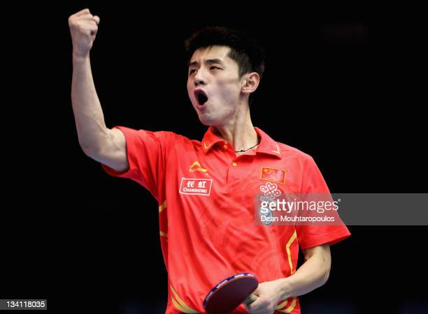 Jike Zhang of China celebrates victory against Liqin Wang of China during the Mens Singles Quarter Finals match during day three of the ITTF Pro Tour...