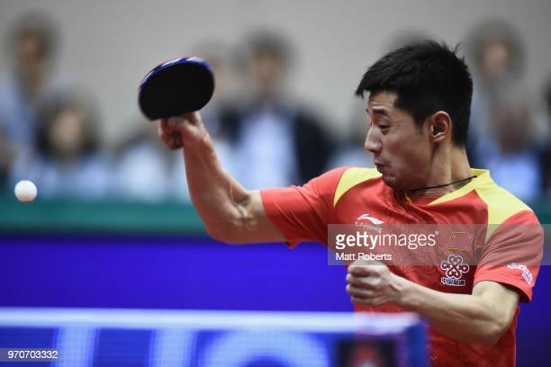 Jike Zhang of China competes against Tomokazu Harimoto of Japan during the men's final on day three of the ITTF World Tour LION Japan Open Ogimura...