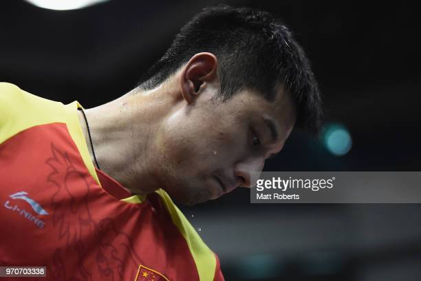 Jike Zhang of China looks dejected against Tomokazu Harimoto of Japan during the men's final on day three of the ITTF World Tour LION Japan Open...
