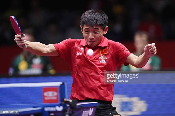 Jike Zhang of China plays a backhand against Dimitrij Ovtcharov of Germany during day eight of the 2014 World Team Table Tennis Championships at...