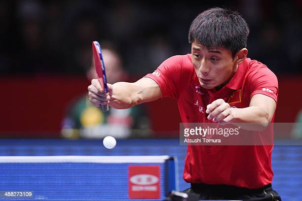 Jike Zhang of China plays a forehand against Dimitrij Ovtcharov of Germany during day eight of the 2014 World Team Table Tennis Championships at...