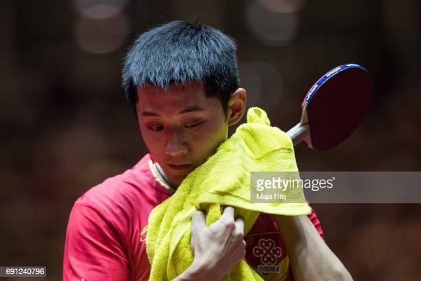 Jike Zhang of China take a break during Men Single 2 Round at Messe Duesseldorf on June 1 2017 in Dusseldorf Germany
