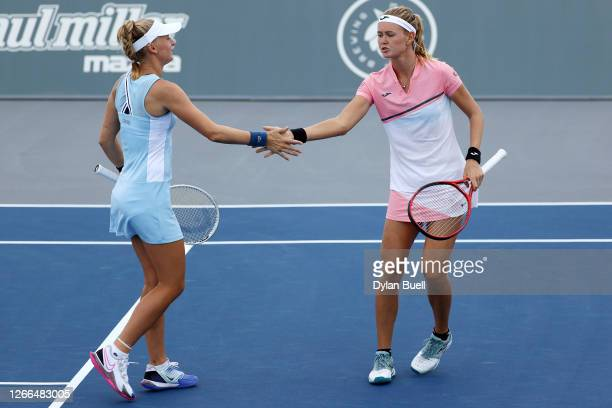 Jil Teichmann of Switzerland and Marie Bouzkova of the Czech Republic celebrate after winning a point during their doubles match against Alexa...