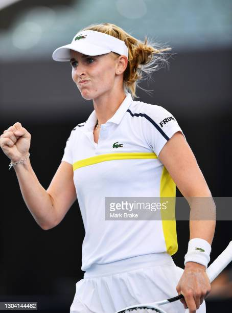 Jil Teichmann of Switzerland celebrates winning a game against Iga Swiatek of Poland during day five of the Adelaide International WTA 500 at...