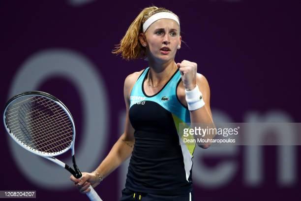 Jil Teichmann of Switzerland celebrates winning a point against Jelena Ostapenko of Latvia during Day 1 of the WTA Qatar Total Open 2020 at Khalifa...