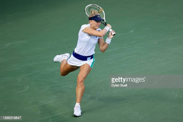 Jil Teichmann of Switzerland plays a backhand during her match against Belinda Bencic of Switzerland during Western & Southern Open - Day 6 at the...