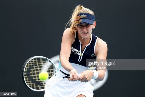 Jil Teichmann of Switzerland plays a backhand during her Women's Singles first round match against Ekaterina Alexandrova of Russia on day one of the...