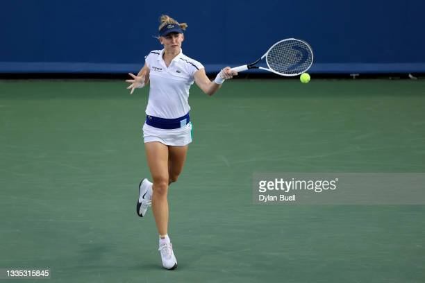 Jil Teichmann of Switzerland plays a forehand during her match against Belinda Bencic of Switzerland during Western & Southern Open - Day 6 at the...