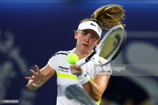 Jil Teichmann of Switzerland returns a forehand in her match against Ons Jabeur of Tunisa during Day Four of the Dubai Duty Free Tennis at Dubai Duty...