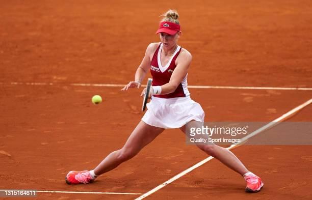 Jil Teichmann of Switzerland returns a shot during her match against Elina Svitolina of Ukraine on day three of the Mutua Madrid Open tennis...