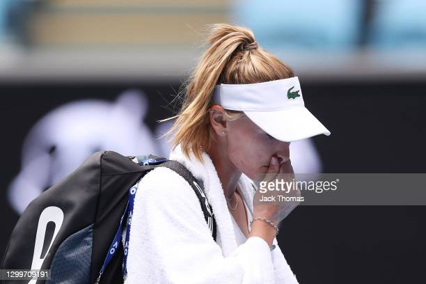 Jil Teichmann of Switzerland walks off the court following defeat in her Women's Singles Round of 64 match against Cori Gauff of The United States of...