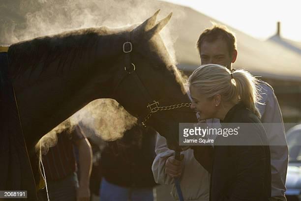 Jill Baffert wife of trainer Bob Baffert kisses Kentucky Derby contender Kafwain during morning workouts for the 129th Kentucky Derby on April 28...