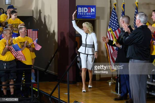 Jill Biden wife of US Vice President Joe Biden waves while arriving on stage during a campaign stop in Pittsburgh Pennsylvania US on Monday April 29...
