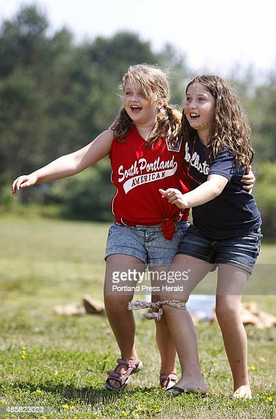 Aileen Campbell left and Sydney Sherburne both 9 and of South Portland compete in a threelegged race at Bug Light Park during a Fourth of July event...