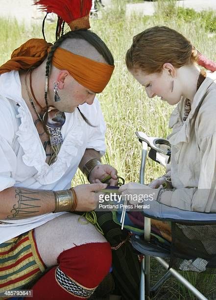 John McBroom and Vanessa Badgley both of North Sutton NH work on a finger weaving piece for a leg garter at the 9th Annual Intertribal PowWow held at...