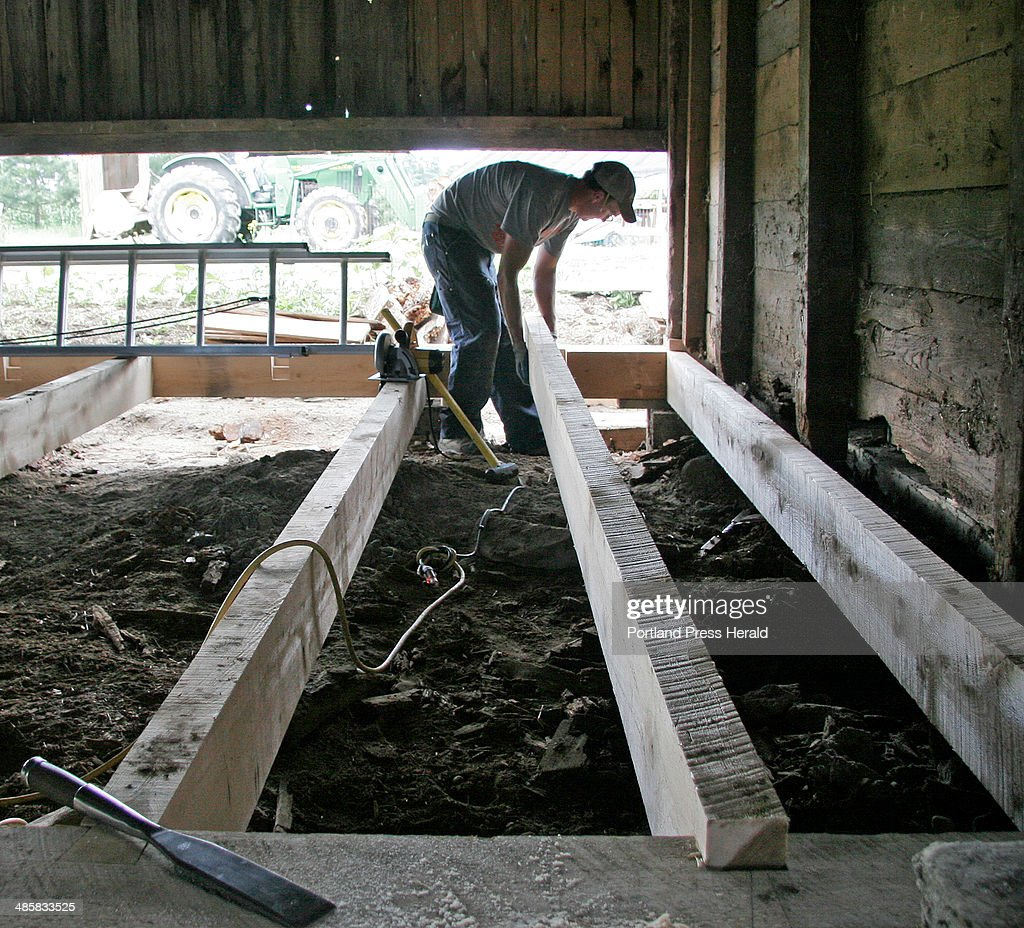 Jon Courtney places a timber in the floor of a barn at Broadturn Farm in Scarborough on Wednesday, : News Photo